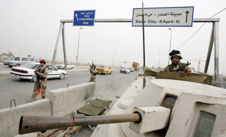 Iraqi soldiers man a checkpoint at the e
