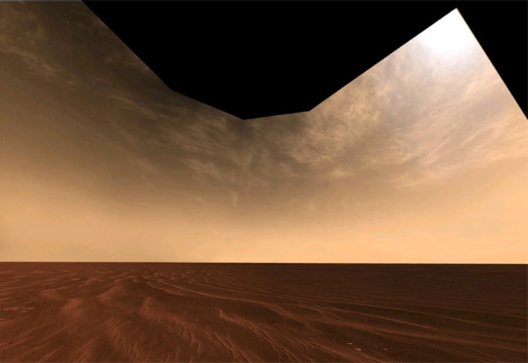 Opportunity rover snapped a picture of a vast, sandy plain and high-flying clouds while exploring Mars' Victoria Crater last October.
