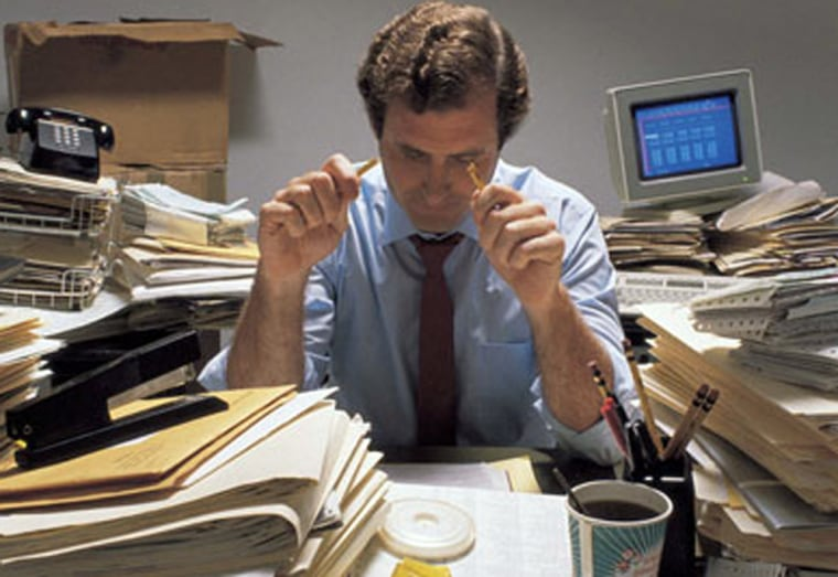 Men are more likely than women to put up with crazy working hours according to a survey.