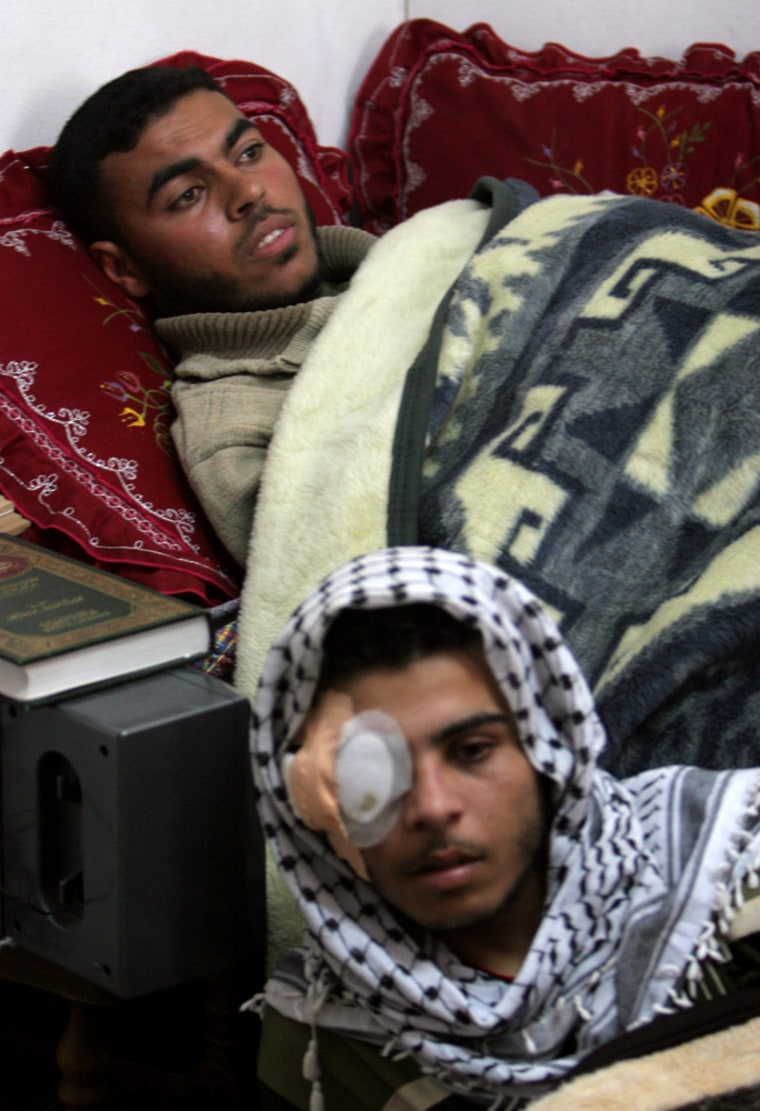Palestinian Hamada al-Ottol, 19, below, and his brother Tahseen, 22, gather together in one room of their family house for the media, in the Jabaliya refugee camp, northern Gaza Strip, onTuesday. The brothers, who fought onopposing sides,were both badly wounded in a recent clash between Hamas and Fatah.