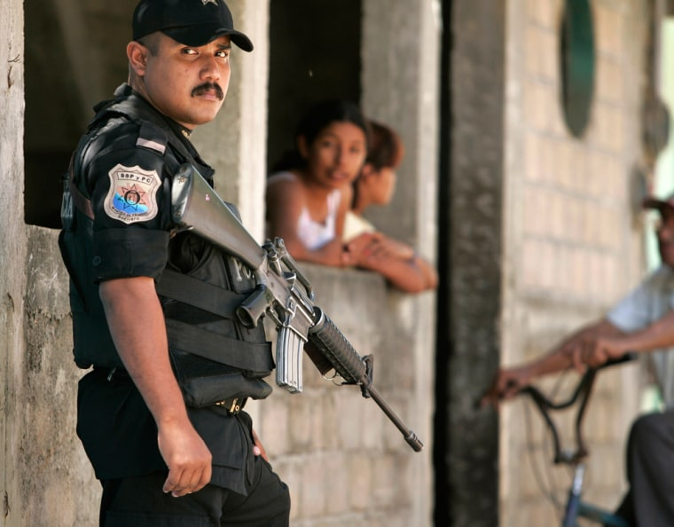 A policeman stands guard in the resort city of Acapulco, Mexico, on Wednesday.