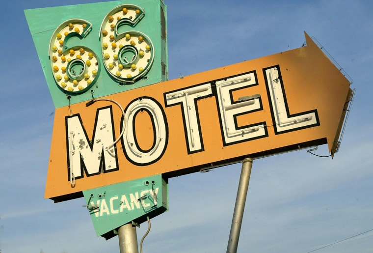 The sign outside the 66 Motel is shown in Needles, Calif. While travelers on a long-haul driving trip probably don't want a posh stay at a nice botique, honeymooners also don't want a stay right off the Interstate.