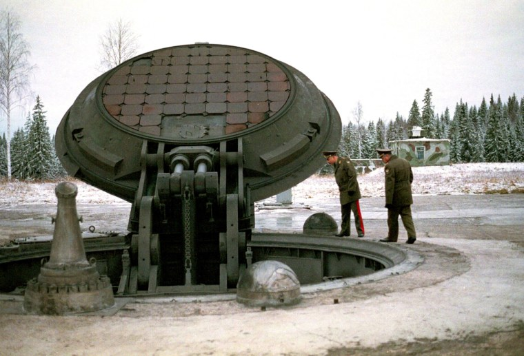 Russian military officials gaze into anintercontinental ballistic missile siloat an undisclosed location. Defense Minister Sergei Ivanov says the military will get 17 ICBMs this year instead of the average of four.
