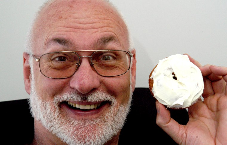 Scientist Robert Bohannon holds a doughnut covered in caffeine icing in his office in Durham, N.C. last month.