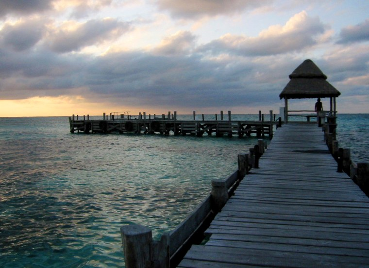 The sun sets near Playa Norte on Isla Mujeres, an island off the Yucatan Coast, Mexico.