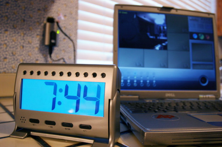 The LukWerks Spy Camera, from Wilifie Inc., is hidden inside a working desk clock and streams video to the PC through the home's electrical outlets using the HomePlug networking standard.