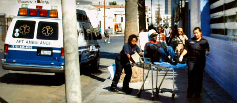 Patient is taken from ambulance to homeless shelter in skid row area of downtown Los Angeles