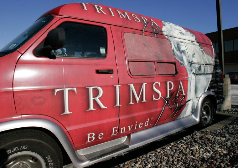 """A TrimSpa van, with a depiction of Anna Nicole Smith and the words """"Be Envied"""" printed on the side, sits in the parking lot of TrimSpa headquarters in Whippany, N.J., last week."""