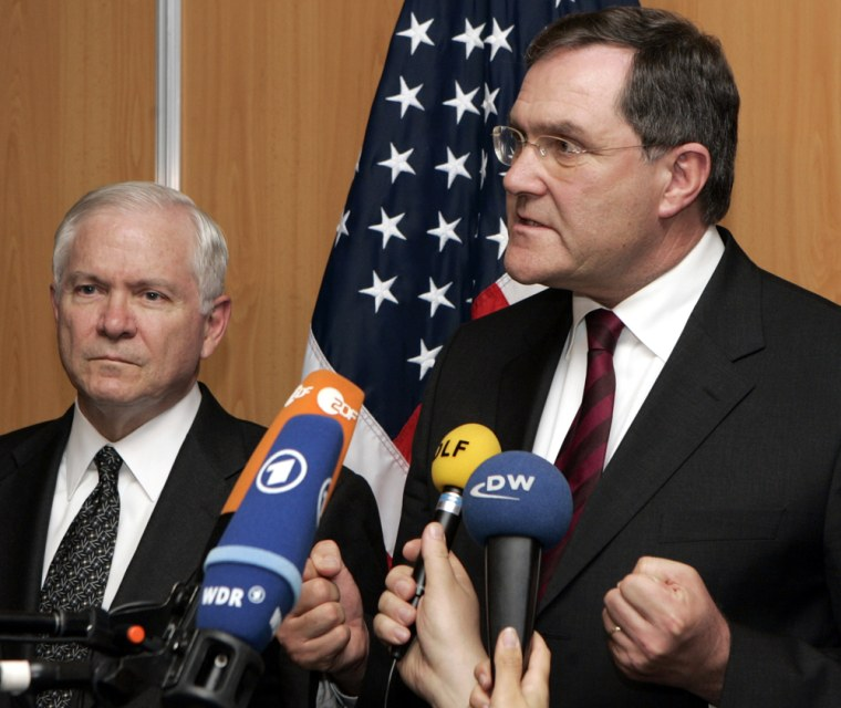 German Defense Minister Franz Josef Jung, right, and U.S. Defense Secretary Robert Gates address journalists at a NATO gathering Friday in Seville, Spain. Gates later traveled to Munich, Germany.