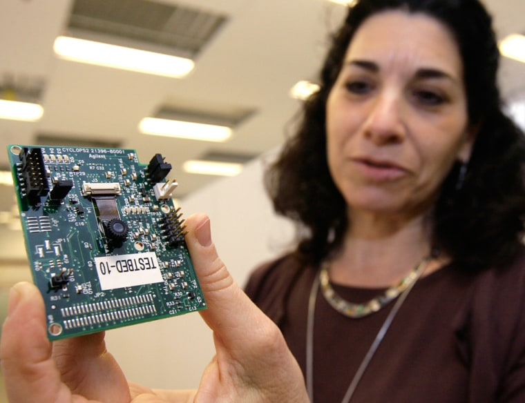 Deborah Estrin displays a sensor for a surveillance camera at the Center for Embedded Networked Sensing, a consortium of six schools headquartered on the UCLA campus. Estrin envisions a day when the tiny sensors embedded in hard-to-reach places become as commonplace as computers plugged into the Internet.