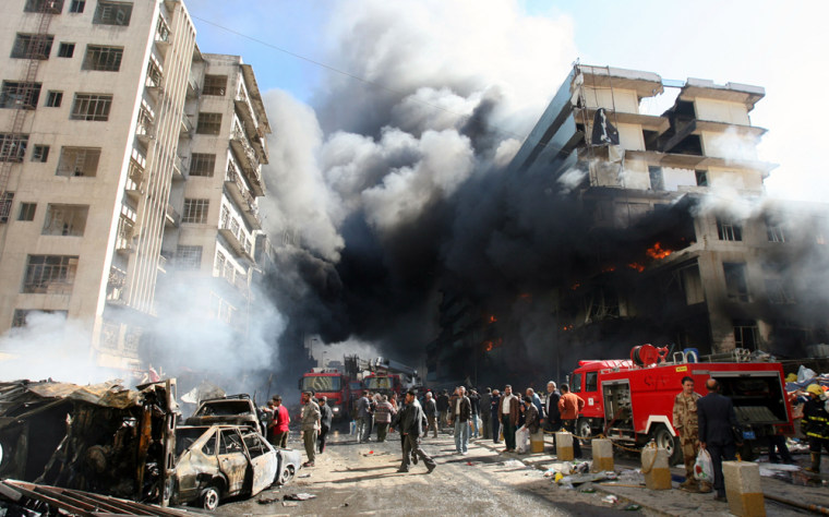 Smoke billows from buildings after a double car bomb attack in central Baghdad on Monday.