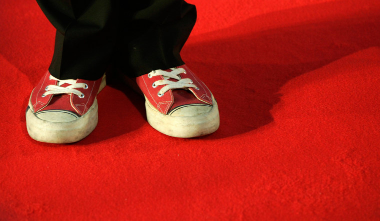 Director Stephen Frears wears red sports shoes as he arrives for the BAFTA awards in London