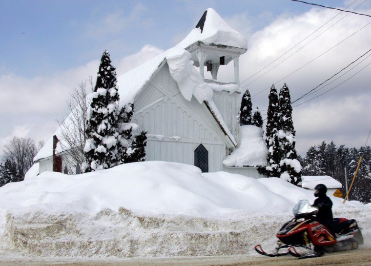 This church in Redfield, N.Y., was among the buildings surrounded, or buried, by snow in upstate New York.
