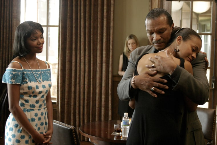 """Actor Billy Dee Williams hugs actress Zoe Saldana in a scene from the film """"Constellation,"""" as actors Gabrielle Union, left, and Eva Carradine, background, look on."""