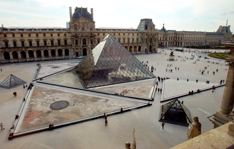 A view of the Louvre's pyramid, and the southern wing of the Louvre building in Paris.