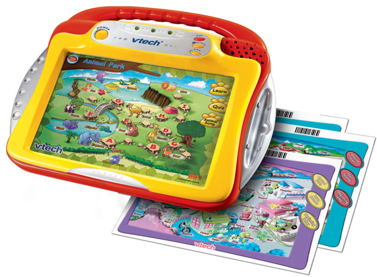 Toy makers are trying to keep up with plugged-in kids by creating playthings, like VTech's Whiz Kid Learning System, that can connect to the computer.
