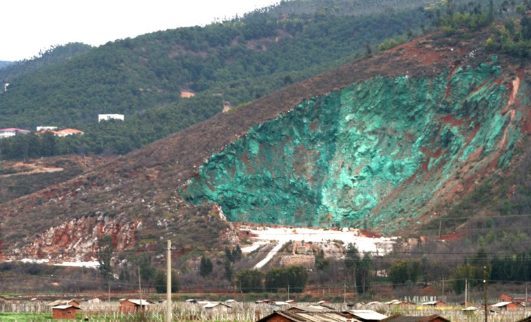 The paint job applied to an abandoned quarry in southwest China stands out with its aquamarine color.