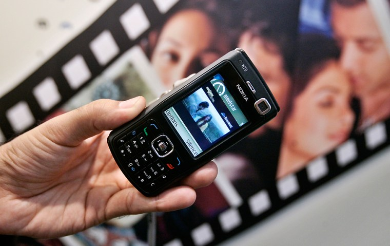 A Bollywood movie is shown on a mobile phone at the annual 3GSM exposition in Barcelona, Spain.