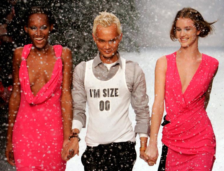 Singaporean designer Isham wears a t-shirt reading 'I'm a size 00' during London Fashion Week