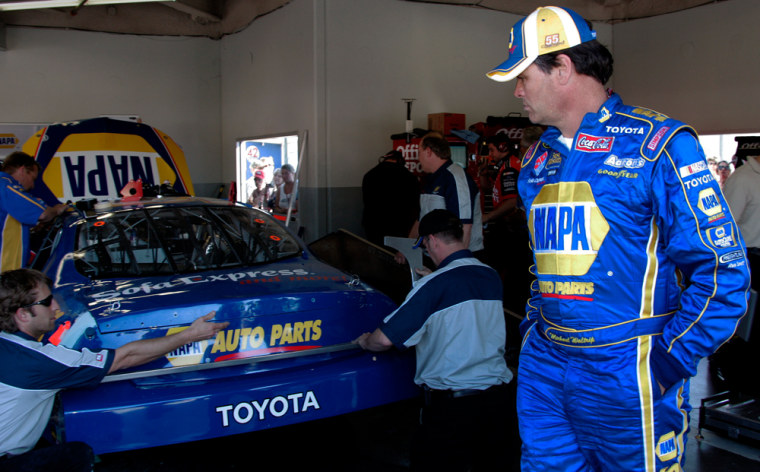 NASCAR driver Michael Waltrip, right, watches as his crew works on his Toyota during practice earlier this week. Waltrip's cheating scandal has dented the automaker's Daytona debut.