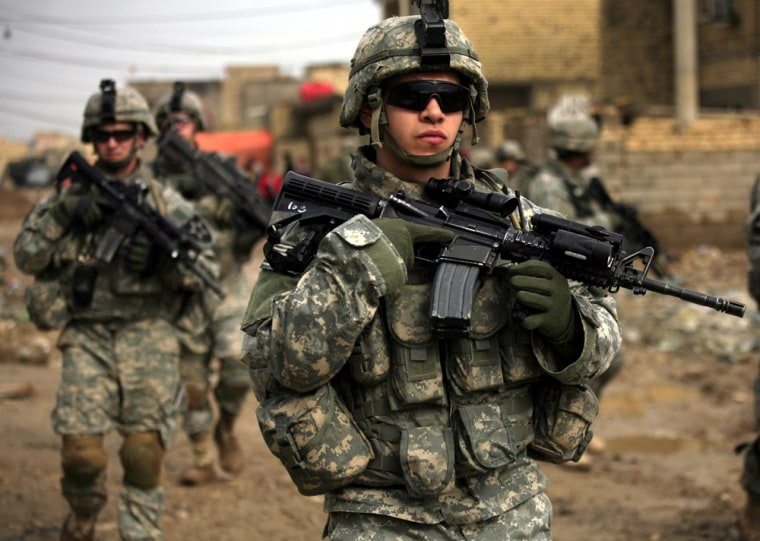 Sgt. John Guerra, 21, from Dallas, Texas, walks with his platoon from the 3rd Stryker Brigade Combat Team during a patrol in the Shaab neighborhood of Baghdad, Iraq, on Friday.
