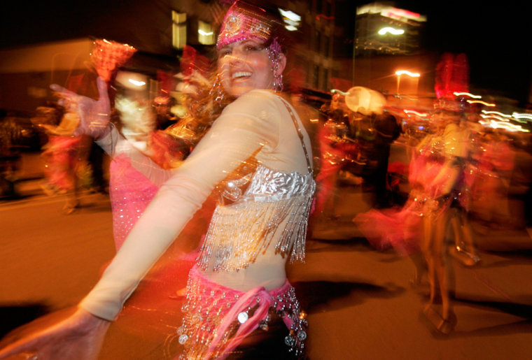 Member of a dance troop performs during Mardi Gras parade in New Orleans
