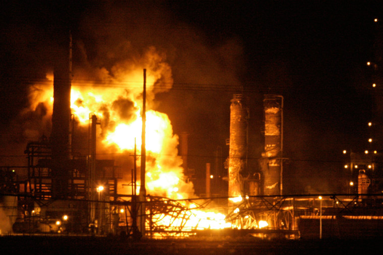 Flames explode from theValero Energy Corp. refinery in Sunray, Texas, on Friday. A cloud of black smoke from the fire was visible from 60 miles away.