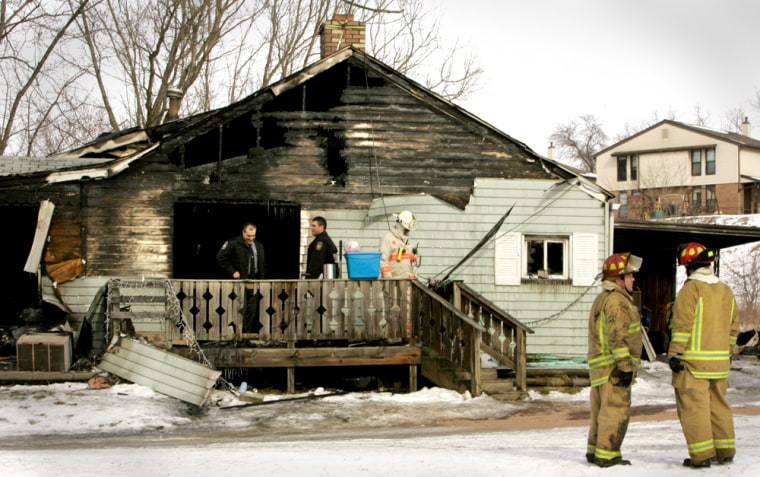 Firemen gather near a home in Waynesburg, Pa., where a fire swept through on Saturday.