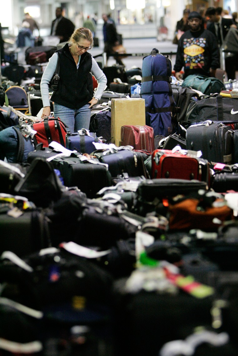 Carolann Manfredi, of Princeton, N.J., searches through luggage for a bag she says has been missing for five days, at the Philadelphia International Airport, Tuesday, Feb. 20, 2007. U.S. Airways said it expects to deliver all the lost luggage to customers by Tuesday. Passengers lost their luggage when flights were canceled last week due to the winter storm.