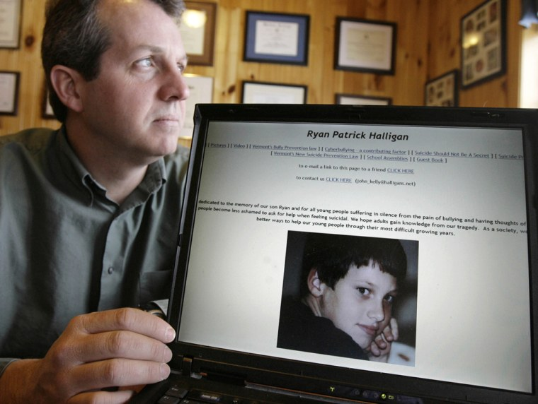 John Halligan shows the Web page devoted to his son, Ryan, at his home in Underhill, Vt. Ryan, bullied by classmates for months online, killed himself in 2003.