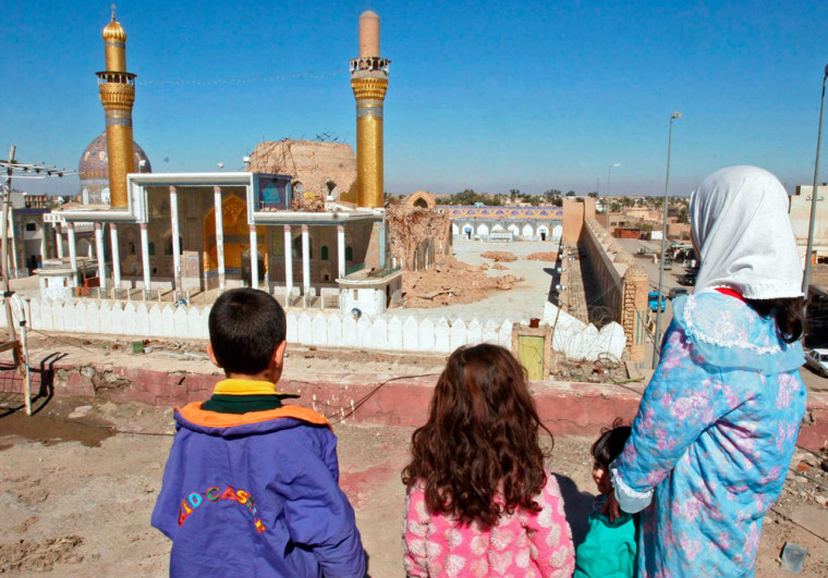 Children stand near the destroyed Shi'ite's Samarra Golden mosque in Samarra