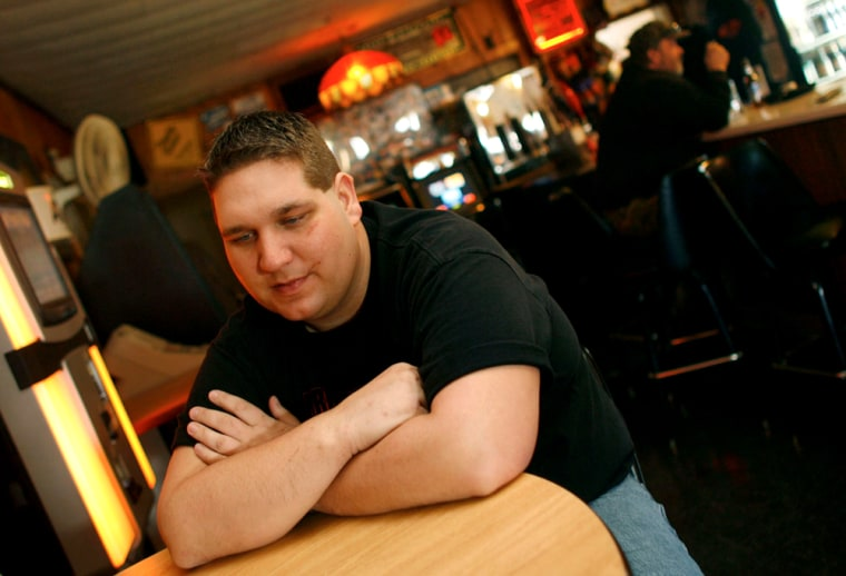 Joshua Hanson talks Tuesday at his bar in Blair, Wis., about the before and after of his 16-story fall.