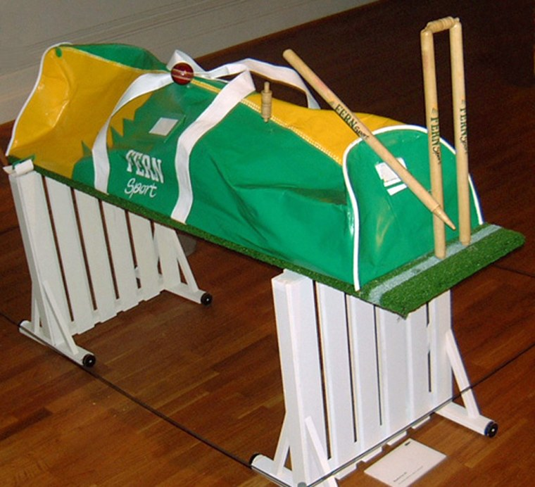 Howzat? This 'crazy coffin,' complete with a wicket and a cricket ball, is apparently designed for a cricket fan.
