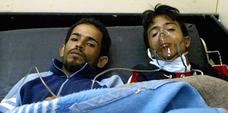 Wounded Iraqis rest at a hospital in Bag