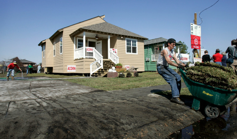 Workers put the finishing touches on what is believed to be two of the first new homes built in the Lower Ninth Ward since Hurricane Katrina hitNew Orleans on Thursday.