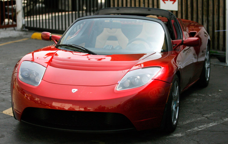 The prototype Tesla Roadster is displayed at a media event touting green transportation in Hollywood