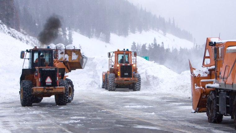 Avalanches aren't just a back country danger. Here crews remove snow from Interstate 40 west of Denver on Jan. 6 after a huge avalanche swept two cars off the road. Eight people were rescued from the buried vehicles.