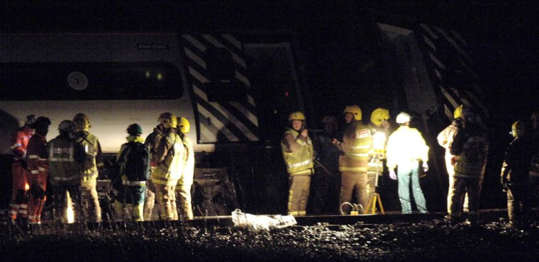 Emergency crews worked into the night Friday after a train derailed near Lambrigg, England.