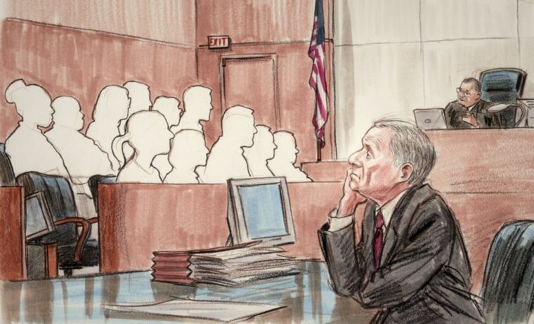 """The remaining 11 jurors (empty chair of the dismissed juror is far left) are instructed by Judge Reggie Walton on Monday to continue their deliberations as """"Scooter"""" Libby watches in foreground."""