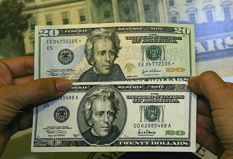 US Treasurer Rosario Marnin displayed the newly redesigned $20 note (top) against the old $20 bill, May, 2002 in Washington, DC.