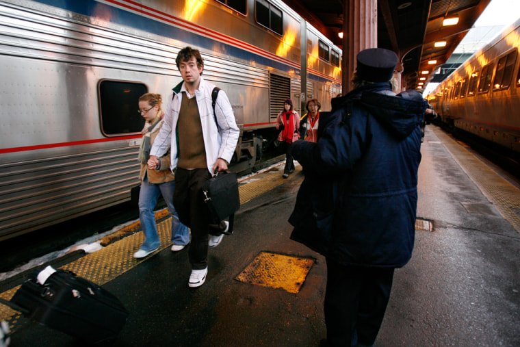Passengers exit the Capitol Limited Amtrak train after a late arrival in Washington from Chicago.
