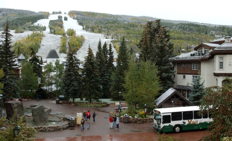 The ski slopes of Vail Mountain, Colo. are shown covered with light snow. Climate change is an increasing threat and concern for ski resorts.