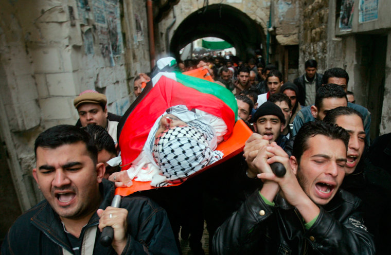 Palestinians carry the body of Annan Tibi during his funeral in the West Bank City of Nablus