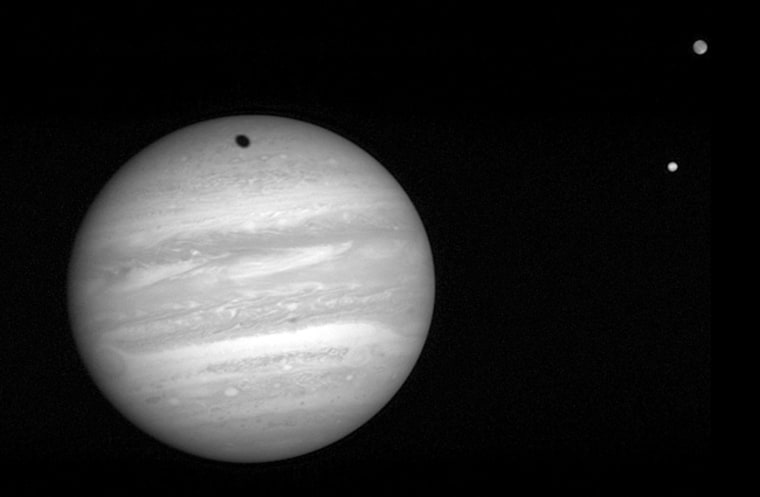 The New Horizons Long Range Reconnaissance Imager took this 2-millisecond exposure of Jupiter on Jan. 24, 2007. At right are the moons Io (bottom) and Ganymede.