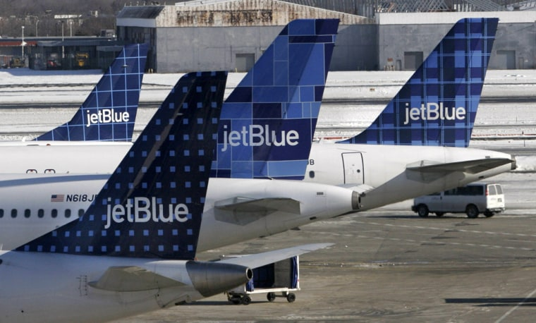JetBlue planes wait at terminal gates at JFK Airport in New York on Feb. 16. JetBlue travelers continued to experience delays and cancellations as the airline struggled for a third day to recover from an operational meltdown.