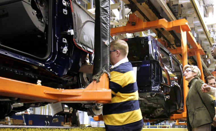 Michigan Gov. Jennifer Granholm looks over the Jeep Commander assembly line during a visit to the Jefferson North Assembly plant in Detroit.