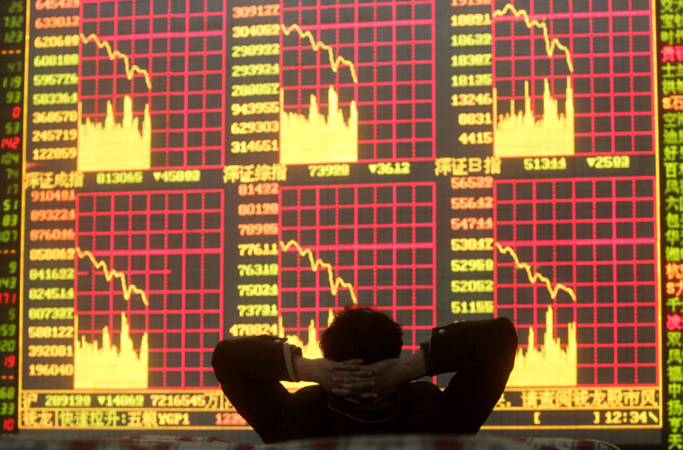 This investor at a stock exchange in China'sSichuan province saw red on Tuesday. Soon the rest of the world — including the U.S. — did too.