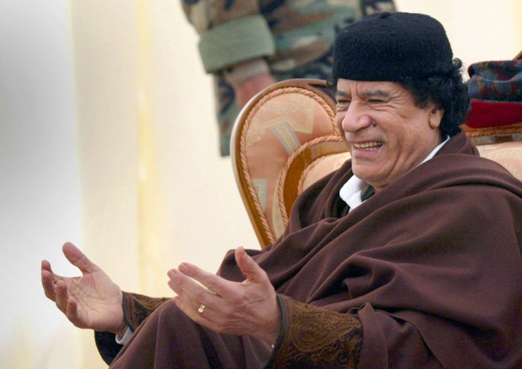 """Libyan leader Moammar Gadhafi, seen here in 2004, said Friday thathis country """"cannot row against the current"""" of globalization."""