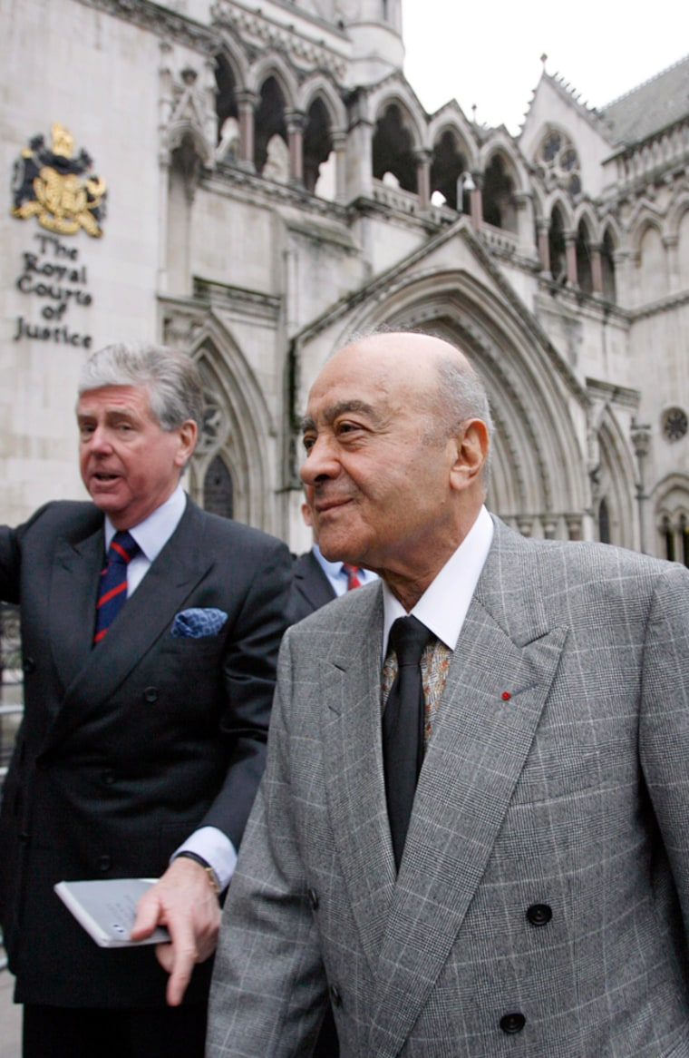 Harrods owner Mohamed Al Fayed and his spokesman Michael Cole leave the High Court in central London