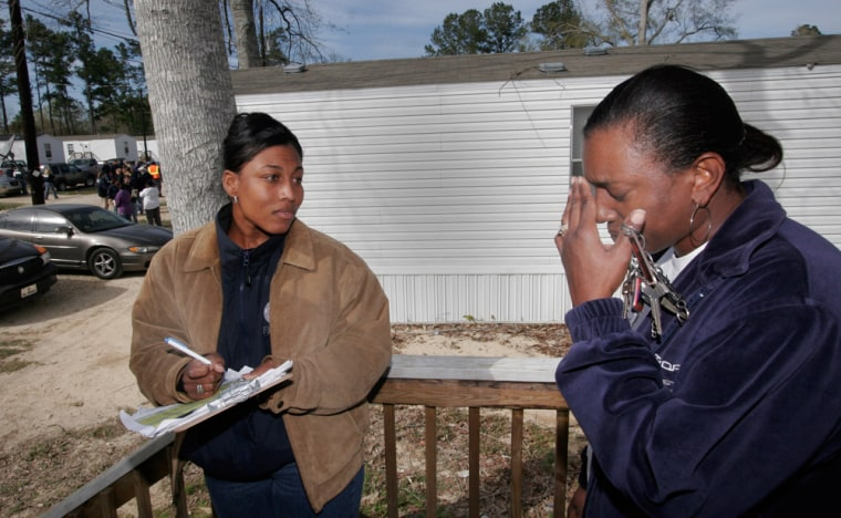 Carolyn Young, right, talks Sunday with FEMA worker Nicole Dumas about where Young is going tolive after she was told bythe agencyto move from her mobile home in Hammond, La. The FEMA mobile home park, set up for victims of Hurricane Katrina, housed 58 families. They weregiven 48 hours to move.